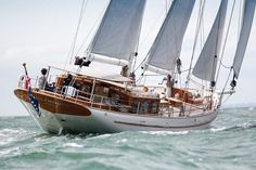 Steve Dews, the world famous sea painter, was hoping for a hint of Nat Herreshoff in Wolfhound's lines. Perhaps they've got it