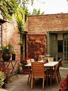 Classic brick adds a rustic feel to this party-ready patio. See more ideas for outdoor spaces: http://www.bhg.com/home-improvement/porch/outdoor-rooms/outdoor-furniture-and-fabric-ideas/?socsrc=bhgpin041713rusticoasis=11