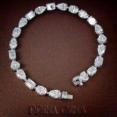 Mix Shape Diamonds Bracelet ( All D Color / VVS-VS / GIA ) size 0.51- 0.55 Ct. Total 23/11.57 Ct.