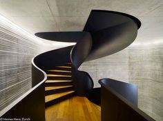 Staircase drilling through the ceiling, Public Records Office Canton Basel-Landschaft by EM2N #architecture
