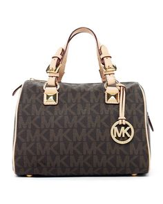 why does michael kors bags look like luxury bag knock offs? this looks like LV