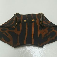 """Alexander McQ bag Alexander McQ Manta bag. Ocelot print thick canvas with black leather bottom & sides. Gold metal zipper & accents. 8""""high x 15"""" at widest point. Comes with dust cover bag. 100% AUTHENTIC Alexander McQueen Bags Clutches & Wristlets"""