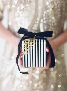 Black ribbon and glitter fern.