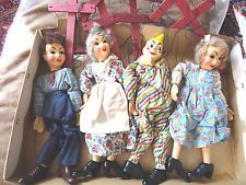 "HAZELLE'S MARIONETTES SET NO. 509-JACK AND JILL & BIMBO included (from left) 803-JACK, 806-MOTHER, 802-BIMBO THE CLOWN and 804-JILL, available in composition 1945-1949 and sold for $11.75 retail.  The original caption for this photo said 1938, but it is not one of the original nine sets produced by Hazelle's in the 1930's.  The earliest copyright on the play ""Jack and Jill Meet Bimbo the Clown"" is 1945.  Also, these puppets have Tenite plastic shoes, introduced in the mid-1940's."
