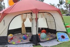 Such a great idea for a kids birthday party!!! Set up a tent and throw beach balls and ball pit balls in it!!