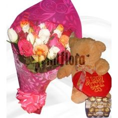 Send instant smiles to your mother in law on her birthday with 12-13 inches brown teddy bear and 24 pieces ferrero rocher chocolate with heart pillow and an abundant bouquet of assorted spray roses featuring 24 beautiful, petite blooms. Each individual spray rose stem features multiple blooms, adding beauty and style (not to mention happiness) to any occasion. Rocher Chocolate, Ferrero Rocher, Online Flower Shop, Brown Teddy Bear, Rose Stem, Heart Pillow, Chocolate Bouquet, First Anniversary, Spray Roses