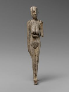 Bone figure of woman.