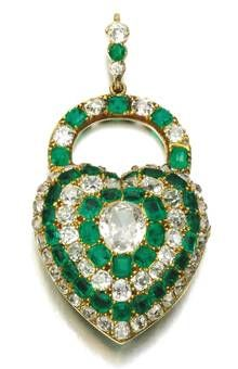 Lot 294: A silver and gold emerald and diamond locket pendant, mid-19th century