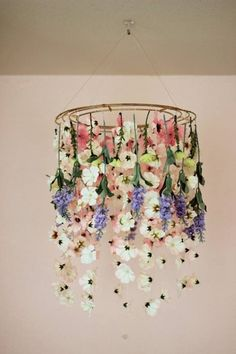 Clear string, fake flowers, wooden hoops, hook