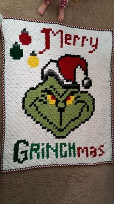 Merry Grinchmas! I created this throw blanket using C2C, but you could also follow the chart and use sc or hdc. Follow the chart, then I did a sc in white all the way around, only putting on sc in each square and one between each square. Sc in green around. Then do the candy cane border (can be found on the Repeat Crafter Me website http://www.repeatcrafterme.com/2016/11/crochet-c2c-ginger...).