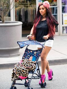 Snooki thinks pushing a stroller around with a baby doll will make her a better mother, or get her ready for motherhood....Ummm, dead wrong there lady.