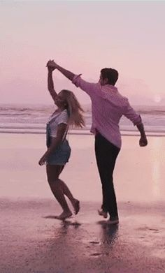 Dancing on the beach make sure to click on it, its a (GIF)