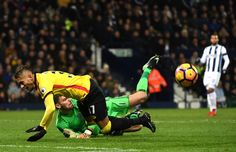 Ben Foster of West Bromwich Albion challenges Roberto Pereyra of Watford during the Premier League match between West Bromwich Albion and Watford at The Hawthorns on December 3, 2016 in West Bromwich, England.