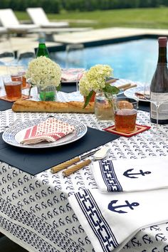 A nautical-inspired classic, our Ahoy hand blocked print features anchors spanning across this easy, breezy, 100% cotton fabric. Whether you're beachside, seaside, lakeside, or landlocked, our Ahoy collection will delight your guests and help make your already special gatherings even more memorable. Nautical Looks, Blue Colour Palette, Anchor Print, Anchors, Pomegranate, Tabletop, Seaside, Cotton Fabric, How To Memorize Things