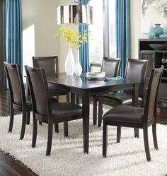 Trishelle 7-Piece Rectangular Dining Table Set with Brown Chairs by Ashley Furniture   Part of the Trishelle Collection Sku: D550-25+6x02 Store Availability: In Stock and On Display Compare At Price: $2,039.93 Sale Price: $1,139.93