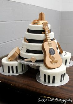 Instrument cake - This is a cake I made for my local fair. The instruments are made of rice crispy treat and covered in fondant/gumpaste. Cake is iced in bc.
