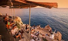 Buza bar...built into the rocks overlooking the ocean. I'd like a cocktail there :)