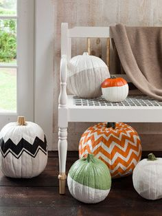 Paint Patterned Pumpkins--using painter's tape and acrylic paint.  I'm thinking this would be cool if I did designs inspired by Mackenzie Child's patterns.