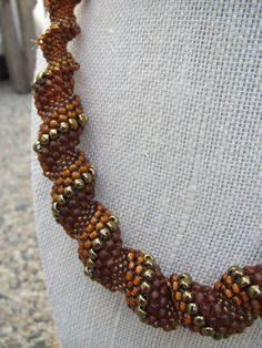 Fall color Beadwoven cellini spiral necklace by Twigsimmortalized