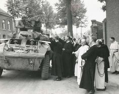 American soldiers are greeted enthusiastically by a group of monks in the town of Ryckholt (Sept. 12th, 1944)