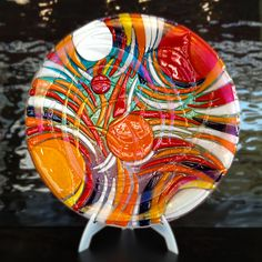 "It's 13"" fused glass charger/platter. It's breathtaking! The colors are amazing and the texture is just crazy - a true piece of art in my book!"