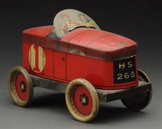 Lot: Early European Tin Litho Racing Car Biscuit Tin., Lot Number: 0072, Starting Bid: $150, Auctioneer: Dan Morphy Auctions LLC, Auction: Toys, Dolls & Figural Cast Iron Day 1, Date: June 24th, 2016 PDT