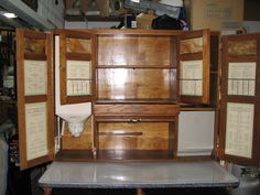 """1919 SELLERS 48""""  """"Mastercraft"""" Kitchen Cabinet.  Has 4 doors with original slag glass, spice  shelf, tambour door, and a secret drawer above tabor.  Door paper inserts with grocery list, cooking  charts, etc.  An innovative 50 lb  automatic lowering flour bin. Lowers  level with the work table, for easy filling, and slips back into place. This cabinet has all the upgrades available, including a meal bin on the far right of the cabinet,""""S"""" latches, ant cups, etc."""