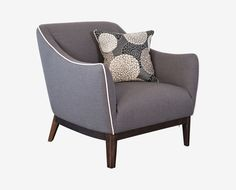 Scandinavian Designs - With gentle curves and clean lines, the Upstil accent chair is a classic choice for your living space. Great attention to detail is shown in the arc of the arms, contrast piping, exposed wood base and tapered legs. Includes one throw pillow.
