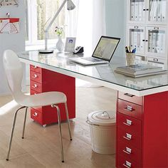 If you are setting up a home office, or space to work at home, you're going to need a desk. This modern desk is made using a couple of secondhand filing cabinets, a glass top, and an inexpensive hollow core door.