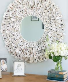 This DIY Oyster Shell Wreath is so easy to make and adds instant charm to your home decor. Not only perfect for coastal decor, but suitable for other decor styles as well.