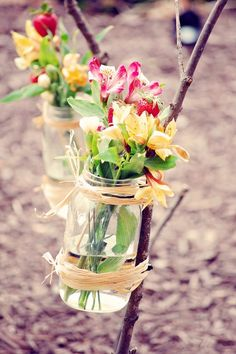 Mason Jar Vases tied to sticks, perfect for lining walk walkways outside!