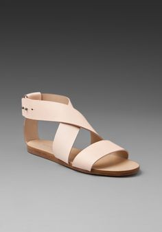 WOMAN BY COMMON PROJECTS Strap Sandal in Creme at Revolve Clothing - Free Shipping!