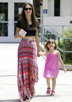 Alessandra Ambrosio looking gorgeous with her daughter while wearing a crop top and flowy patterned skirt