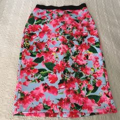 Milly For DesigNation Floral Pencil Midi Skirt Fun and flirty floral pencil skirt by Milly for Design Nation.  Size medium with a black elastic waistband. Some minor snagging on waistband but hardly noticeable.  Stretchy scuba type fabric.  Back slit.  Feel free to make an offer! Milly Skirts Pencil