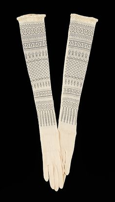 "Evening Gloves: 1900-1910, American, silk.     ""The openwork knit pattern adds an extra decorative dimension to the wearer's arms. The combination of the silk knit and the patterned knit is not unlike the way silk stockings covered and decorated the legs."""