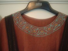 Viking Dress Collar Detail by EvaLiz, via Flickr The other photos of embroidery are worth checking out too.