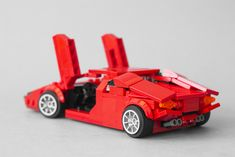 Countach rear side high angle open doors -Lamborghini Countach rear side high angle open doors - Little Red Corvette Lego brick build Ford Mustang Fastback 1968 Bullitt s… Lego Structures, Lego Wheels, Lego Creative, Lego Pictures, Lego Speed Champions, Lego Builder, Lego Craft, Lego Worlds, Cool Lego Creations