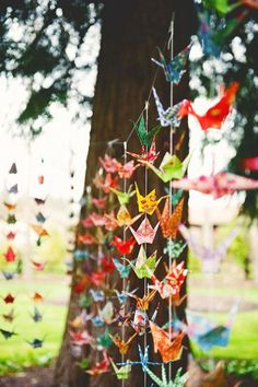 Wedding by Stephanie Haller Photography Origami cranes strung on fishing line make a beautifully colorful backdrop at an outdoor reception.Origami cranes strung on fishing line make a beautifully colorful backdrop at an outdoor reception. Origami Wedding, Diy Wedding, Wedding Simple, Wedding Ideas, Party Wedding, Wedding Reception, 2017 Wedding Trends, Wedding 2017, Paper Backdrop