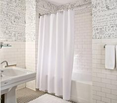 Designed by William Sofield in 1996, the interiors of the Soho Grand Hotel in New York have stood the test of time. We especially like Sofield's all-white baths, which have a jazzy urban edge thanks to the kinetic wallpaper by legendary New Yorker magazine cartoonist Saul Steinberg. Recreate the look with the following elements.