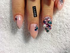 ohvi:  Diamonds and Pearls! Stiletto shaped nails with random colored stones and pearls.