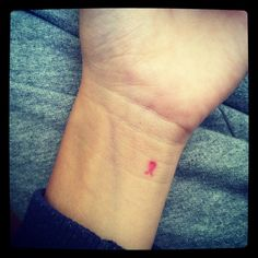 simple breast cancer tattoo. If I have the guts...I want to do this.