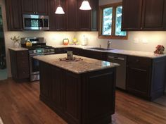 Dark stained Cherry cabinetry for this kitchen remodel.