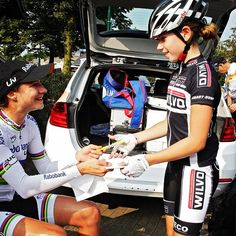 Young cyclist getting an autograph from the great Marianne Vos
