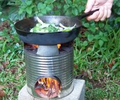 """DIY Camping Or Picnic Stove Rocket stove in use - everyone needs to know how to build/use one of these for """"those"""" times when there's no other way to cook. Camping,camping tips,Clever and Simple Ideas,DIY, Diy Camping, Camping Survival, Survival Prepping, Emergency Preparedness, Survival Skills, Camping Stove, Camping Ideas, Camping Hacks, Wilderness Survival"""