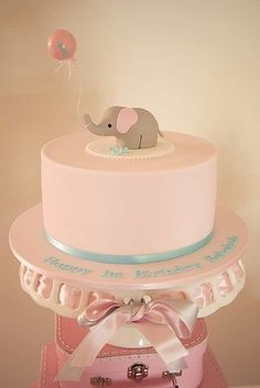 birthday party was themed around baby elephants which was nicely complimented by the pink, grey and aqua colour accents used in the decor and party food.For a full list of suppliers vist Tanya's blog.
