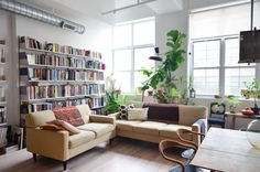 The two couches are a vintage find. The wall-mounted shelves are from Vitsoe.
