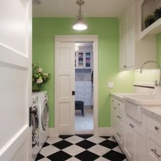 Laundry Room Design--color on walls, black/white tile floor. white cabs.