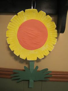 Paper Plate flower with hand prints leaves!