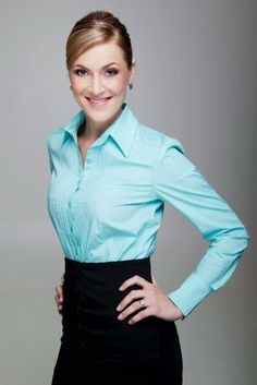 Office wear. Blue collared button down shirt with black pencil skirt. Corporate look.
