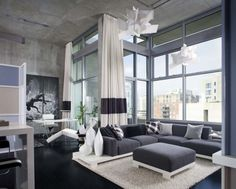 style + materials and HUGE floor to ceiling curtains...